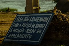 No swimming area - risc of drowning Sao Francisco river stock photography