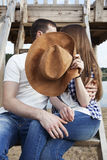 Not to look!. Kissing couple on the nature Royalty Free Stock Photography
