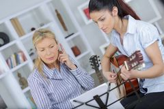 Not in the tune. Work Stock Photo