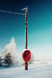 Not used red phone hanging in winter field Royalty Free Stock Photography