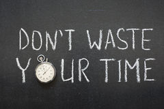 Not waste time. Dont waste your time phrase handwritten on chalkboard vintage precise stopwatch used instead of O Royalty Free Stock Photography