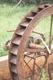 Not working old rusty water wheel abandoned to time.  stock photography