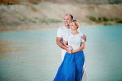 Not a young man and woman embracing. Not a young married couple embrace on a background of lake Stock Photo