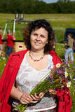 Not young woman with a bouquet of wildflowers Royalty Free Stock Photography