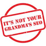 Not your grandmas seo illustration. Red grunge stamp with it's not your grandma's seo illustrated on white Royalty Free Stock Photo