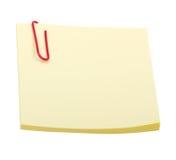 Nota amarela da etiqueta com o grampo isolado no branco Fotografia de Stock Royalty Free