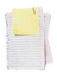 Nota amarilla con el clip de papel Fotos de archivo