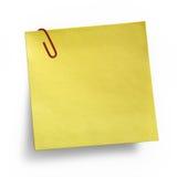 Nota amarilla con el clip de papel Imagen de archivo libre de regalías