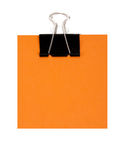 Nota arancione e graffetta nera Immagine Stock