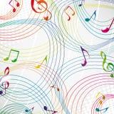 Nota colorida de la música sobre un fondo gris. Foto de archivo
