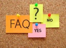 Nota con il FAQ Fotografia Stock