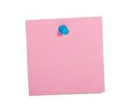 Nota cor-de-rosa do lembrete com pino azul Fotografia de Stock