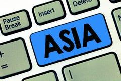 Nota da escrita que mostra Ásia Foto do negócio que apresenta o continente o maior e populoso oriental e o hemisfério Norte foto de stock royalty free