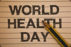 Nota da escrita que mostra o dia de saúde de mundo A foto do negócio que apresenta a data especial para atividades saudáveis impo imagens de stock royalty free
