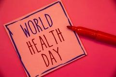 Nota da escrita que mostra o dia de saúde de mundo A foto do negócio que apresenta a data especial para atividades saudáveis impo foto de stock royalty free