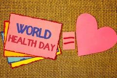 Nota da escrita que mostra o dia de saúde de mundo A foto do negócio que apresenta a data especial para atividades saudáveis impo fotos de stock royalty free