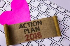 Nota da escrita que mostra o plano de ação 2018 Foto do negócio que apresenta para fazer a lista nos alvos dos objetivos da defin Foto de Stock