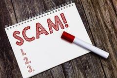 Nota da escrita que mostra Scam Foto do negócio que apresenta a fraude desonesta do esquema que rouba alguém dinheiro ou informaç imagem de stock royalty free