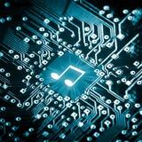 Nota da música no chip de computador Fotografia de Stock Royalty Free