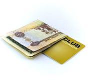 Nota de cinco dirhams e cartão do clube da sociedade do ouro sobre fotos de stock