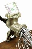 nota de dólar 100 em uma picadora de carne Imagem de Stock Royalty Free