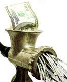 nota de dólar 100 em uma picadora de carne Foto de Stock Royalty Free