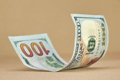 Nota de dólar nova rolada do americano cem Foto de Stock Royalty Free