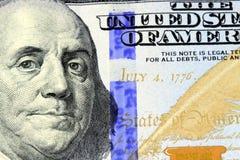 Nota de dólar da moeda cem dos E.U. Fotografia de Stock