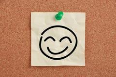 Nota de la cara de la sonrisa Imagenes de archivo