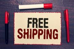 Nota de la escritura que muestra el envío gratis Acarreo de exhibición del envío de la carga útil del cargamento del envío del ca foto de archivo libre de regalías