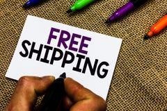 Nota de la escritura que muestra el envío gratis Acarreo de exhibición del envío de la carga útil del cargamento del envío del ca imagen de archivo libre de regalías