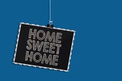 Nota de la escritura que muestra el hogar dulce casero Foto del negocio que muestra en el tiempo relajado de la familia de la sen stock de ilustración