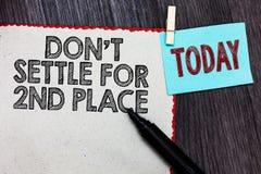Nota de la escritura que muestra el Settle de Don t no para el 2do lugar La foto del negocio que le muestra puede ser la primera  fotos de archivo libres de regalías