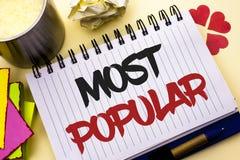 Nota de la escritura que muestra la más popular Foto del negocio que muestra el producto o al artista preferido 1r del bestseller Fotografía de archivo libre de regalías