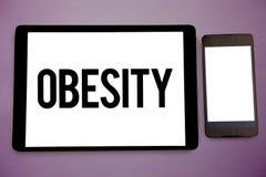 Nota de la escritura que muestra obesidad El exceso de exhibición de la dolencia de la foto del negocio de grasas de cuerpo acumu Foto de archivo