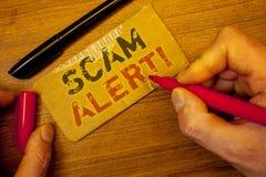 Nota de la escritura que muestra a Scam llamada de motivación alerta Fotos del negocio que muestran la advertencia de la segurida Fotografía de archivo