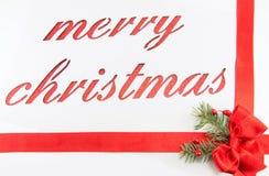 Nota de la Feliz Navidad cortada del papel Fotos de archivo libres de regalías