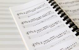 Nota de la música Imagen de archivo libre de regalías