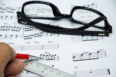 Nota de la música para la idea de la canción Fotografía de archivo libre de regalías