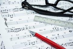 Nota de la música para la idea de la canción Fotografía de archivo