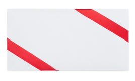 Nota de la tarjeta con la cinta roja Fotografía de archivo