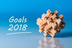 Nota 2018 de las metas sobre blancos, meta, sueños y promesas del ` s del Año Nuevo para el próximo año Enigma un símbolo de Imagen de archivo