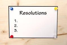 Nota de las resoluciones del Año Nuevo sobre la madera en espacio en blanco Imagenes de archivo