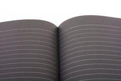 Nota de livro aberta do preto Fotos de Stock Royalty Free