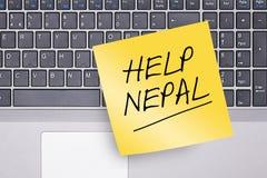 Nota de Nepal de la ayuda sobre el teclado Fotos de archivo libres de regalías