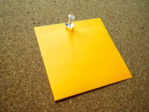 Nota de post-it anaranjada Fotografía de archivo libre de regalías