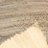 Nota del documento in bianco nella struttura della spiaggia della sabbia Fotografia Stock