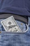 Nota del dollaro americano in una tasca Immagine Stock