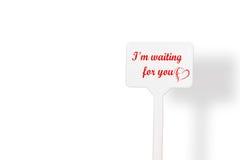 Nota del recordatorio con el día del ` s de la tarjeta del día de San Valentín Imagen de archivo libre de regalías