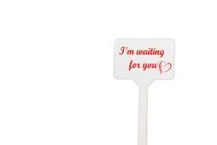 Nota del recordatorio con el día del ` s de la tarjeta del día de San Valentín Fotografía de archivo libre de regalías